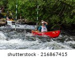 Small photo of MINDEN, ONTARIO - SEPTEMBER 6, 2014: An unidentified contestant competes at 2014 Open Canoe Slalom Race at Gull River in Minden, Ontario, Canada.