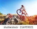 mountain biker in action across ... | Shutterstock . vector #216955021