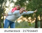 father with her little daughter ... | Shutterstock . vector #217016665