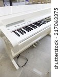 Small photo of White piano on stage, detail musial instrument of classical music