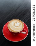 hot latte coffee on wooden | Shutterstock . vector #217081681