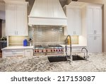 Stock photo luxury kitchen detail island counter top sink cabinets range and oven 217153087