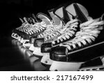 pairs of hockey skates lined up ... | Shutterstock . vector #217167499