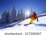 skier skiing downhill in high... | Shutterstock . vector #217200307