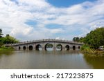 Old Arch Bridge On The Lake In...