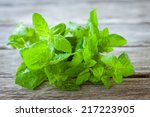 Bunch Of Fresh Mint On A Woode...