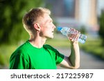 tired man drinking water from a ... | Shutterstock . vector #217225987