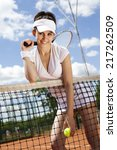 girl playing tennis on the court | Shutterstock . vector #217262509