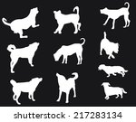 Stock vector illustration with dog silhouettes isolated on black background 217283134
