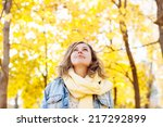 Beautiful Woman In Autumnal Park