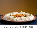 rice on brown plate with... | Shutterstock . vector #217301104