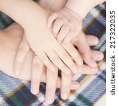 four hands of the family  baby  ... | Shutterstock . vector #217322035
