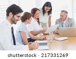 business team in a meeting at... | Shutterstock . vector #217331269