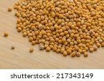 mustard seeds on the desk | Shutterstock . vector #217343149