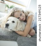 beautiful woman hugging dog on... | Shutterstock . vector #217349125
