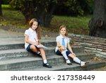 two girls in school uniform ... | Shutterstock . vector #217358449
