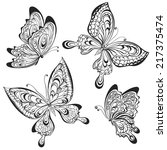Stock vector vector set of black calligraphic butterflies isolated on white background tattoo design 217375474
