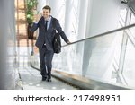 businessman smiling at the... | Shutterstock . vector #217498951