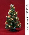 decorated miniature christmas tree - stock photo