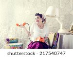 vintage housewife chats on the... | Shutterstock . vector #217540747