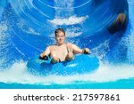 Man Having Fun  Sliding At...