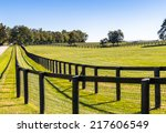 double fence at horse farm.... | Shutterstock . vector #217606549