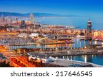 Barcelona City And Port In...