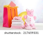 Baby Clothes And Gift Bag On...
