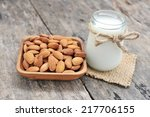 almonds milk  with almonds on... | Shutterstock . vector #217706155