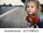 lonely and frozen little girl | Shutterstock . vector #217708921