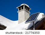 A small solar panel installed on a mountain house roof - stock photo