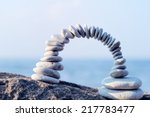 arch of white pebbles in the... | Shutterstock . vector #217783477