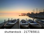 Foggy and tranquil sunrise at a small marina on a lake. - stock photo