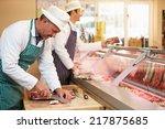 two butchers preparing meat in...   Shutterstock . vector #217875685