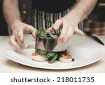 chef is cooking appetizer with... | Shutterstock . vector #218011735