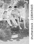 happy family in garden   Shutterstock . vector #218045605