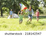 family flying kite camping... | Shutterstock . vector #218142547