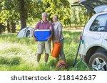 senior couple unpacking car for ... | Shutterstock . vector #218142637