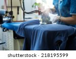 image of laundry worker at work | Shutterstock . vector #218195599