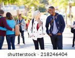 Stock photo students walking outdoors on university campus 218246404
