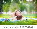girl lying on the grass on a... | Shutterstock . vector #218254264