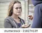 teenage girl buying drugs on... | Shutterstock . vector #218274139