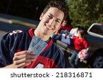 tailgate  guy fan holds up...   Shutterstock . vector #218316871