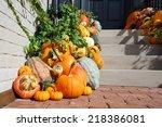 Pumpkins In Front Door To...