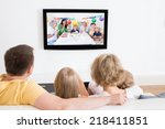young family watching tv... | Shutterstock . vector #218411851