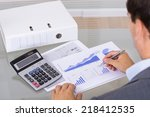 analyst working with graph.... | Shutterstock . vector #218412535