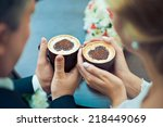 hands of the groom and the... | Shutterstock . vector #218449069