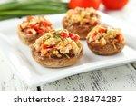 stuffed mushrooms on plate on... | Shutterstock . vector #218474287