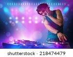 young disc jockey mixing music... | Shutterstock . vector #218474479
