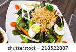 tuna salad topped with garlic...
